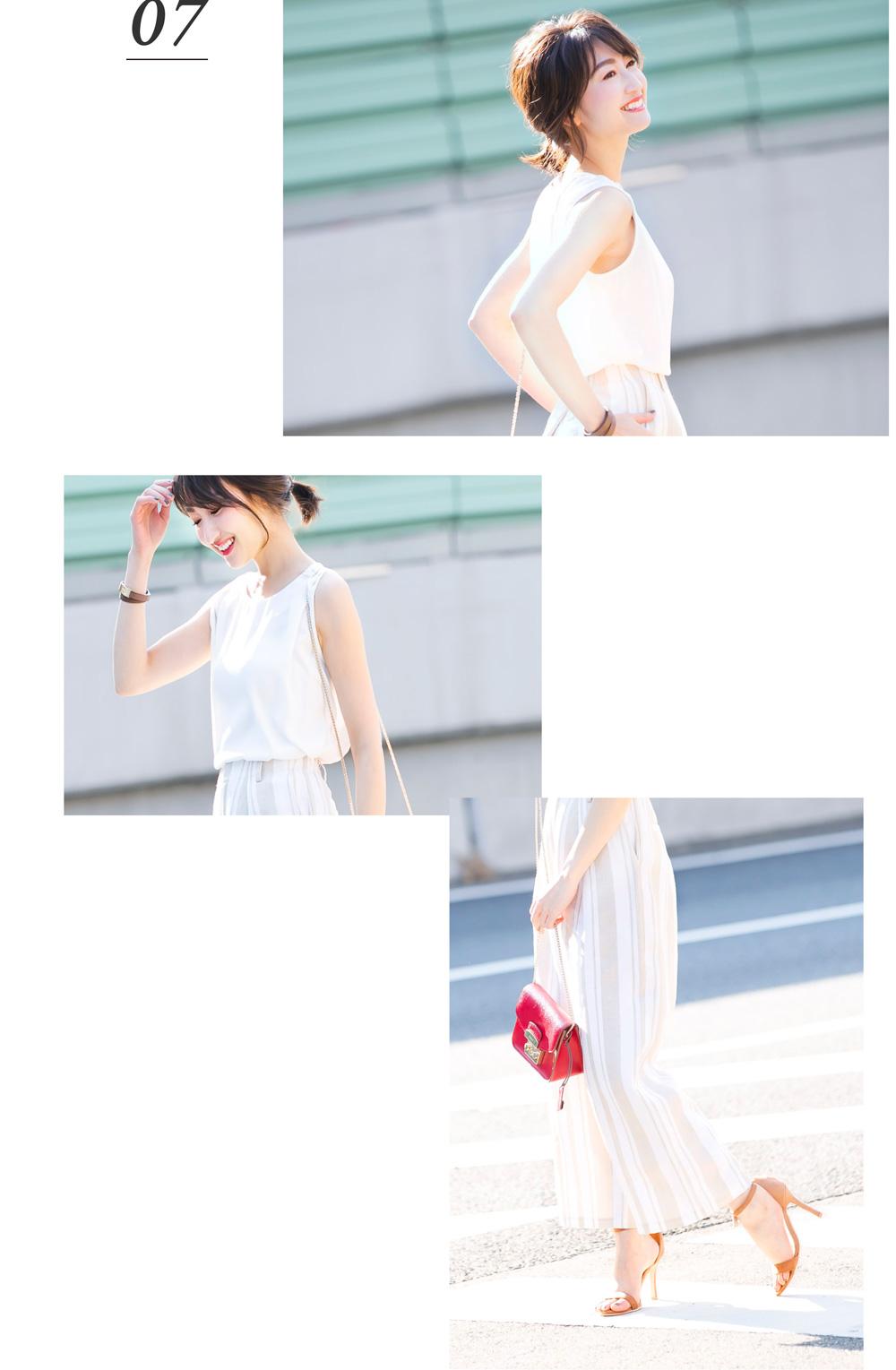 金子麻貴さんがプルオーバーにリネンワイドパンツを合わせたコーデでポージング