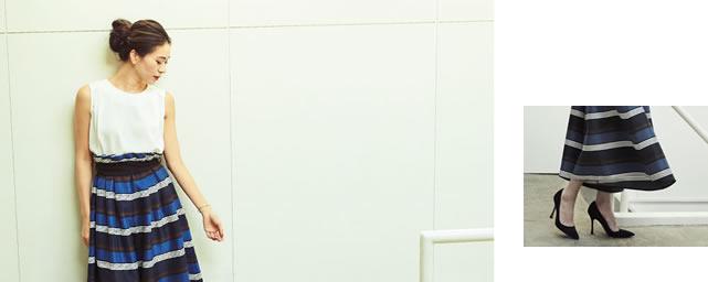 リネンライクなボーダーリボンベルトパンツを穿いて下を向いている大日方久美子さん